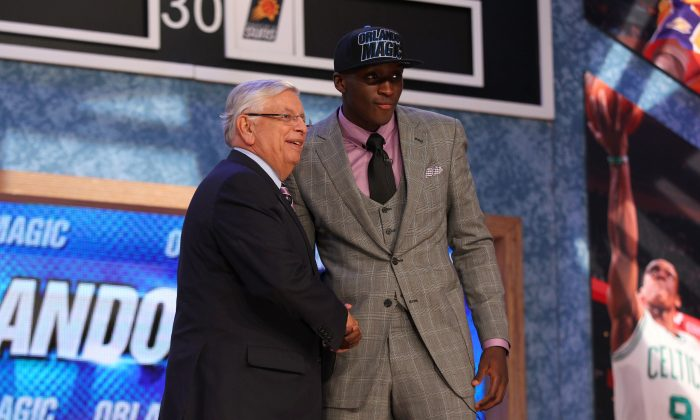Victor Oladipo (R) of Indiana poses for a photo with NBA Commissioner David Stern after Oladipo was drafted #2 overall in the first round by the Orlando Magic during the 2013 NBA Draft at Barclays Center on June 27, 2013 in in the Brooklyn Borough of New York City. (Mike Stobe/Getty Images)