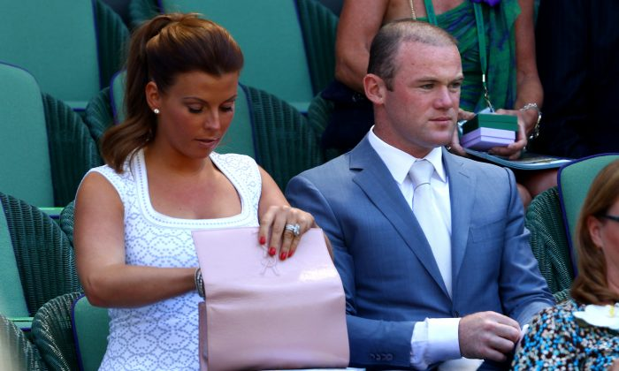 Coleen Rooney with her husband Wayne in a file photo. (Getty)