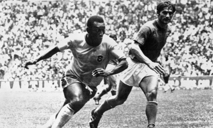 Brazilian midfielder Pelé (L) dribbles past Italian defender Tarcisio Burgnich during the World Cup final on 21 June 1970 in Mexico City. Pelé scored the opening goal for his team as Brazil went on to beat Italy 4-1 to capture its third World title after 1958 (in Sweden) and 1962 (in Chile). (AFP/Getty Images)