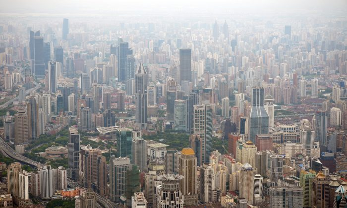 This photo taken on August 2, 2013 shows commercial and residential property from the under construction Shanghai Tower in Pudong, Shanghai. Chinese property prices increased at a faster rate in September than the previous month as the effect of price-control policies weakened, a survey said on September 30. (Peter Parks/AFP/Getty Images)