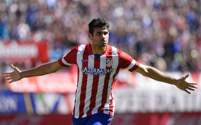 Atletico Madrid's Brazilian forward Diego da Silva Costa celebrates after scoring during the Spanish league football match Club Atletico de Madrid vs RC Celta de Vigo at the Vicente Calderon stadium in Madrid on October 6, 2013. (PIERRE-PHILIPPE MARCOU/AFP/Getty Images)