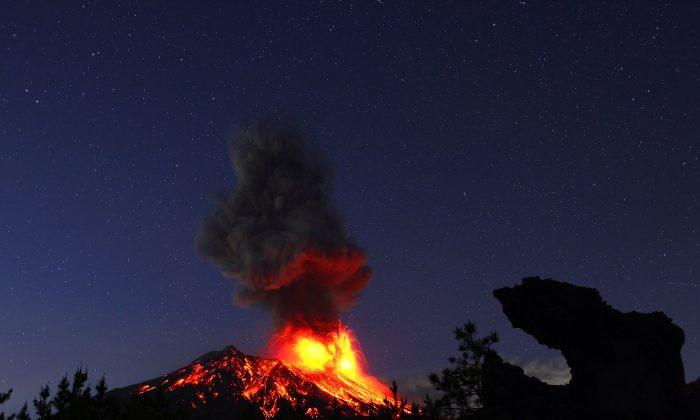 """Smoke Rising from the Volcanic Eruption Sakurajima,"" 2013, by Takehito Miyatake. (Courtesy of Takehito Miyatake)"