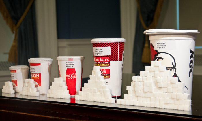 Soft-drink cups in different sizes and corresponding amounts of sugar are displayed at a news conference, at New York City Hall on May 31, 2012. (Christian Watjen/Epoch Times)