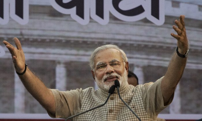 Narendra Modi, India's Prime Minister, gestures while speaking to supporters after his landslide victory in elections on May 16, 2014 in Vadodara, India. Modi's government could change the power dynamics in Asia if it fulfills its promises to make India internally strong. (Kevin Frayer/Getty Images)