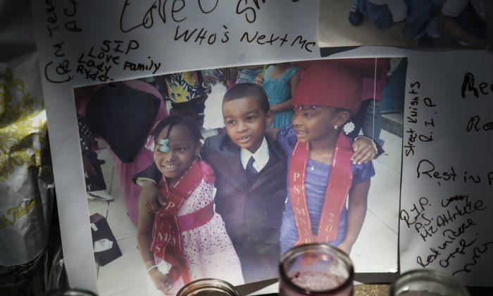 The vigil for Prince Joshua Avitto (C), 6, who was stabbed to death on June 1, at the Boulevard Housing project in East New York City on June 3, 2014. (Samira Bouaou/Epoch Times)