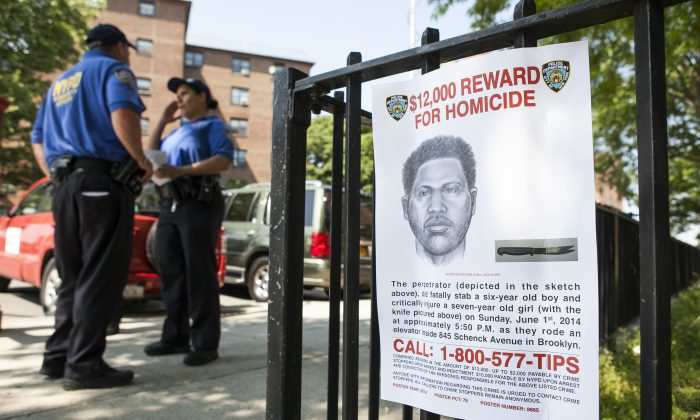 A sign depicting the perpetrator of the stabbing to death of Prince Joshua Avitto, at the Boulevard Housing project in East New York on June 3, 2014. (Samira Bouaou/Epoch Times)