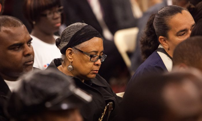 Doris McCoy, grandmother of late Avonte Oquendo, listens to opening remarks at a City Council hearing on Avonte's Law, Manhattan, June 12. (Petr Svab/Epoch Times)