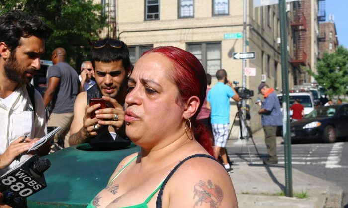 Marisoo Perez, a friend of the Esteves family, near the Joseph Wade Middle School in the Bronx, June 18. (Brendon Fallon/Epoch Times)