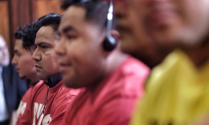 Car wash owners and workers listen to testimony during a hearing on car wash licensing at the City Hall in Manhattan on June 19. (William Alatriste/City Council)
