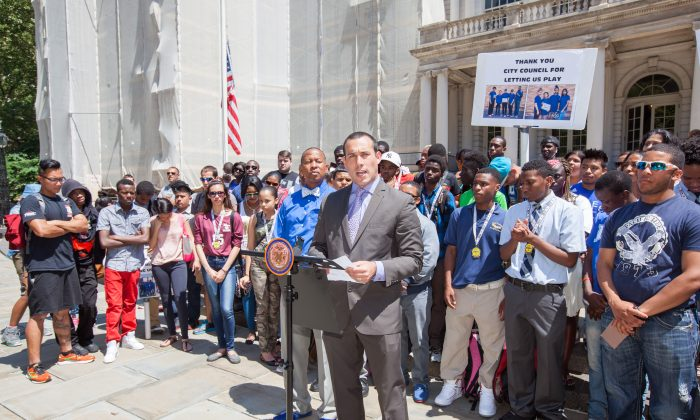 David Garcia-Rosen, founder of the Small Schools Athletic League, speaks at a City Hall rally on Monday. (Petr Svab/Epoch Times)