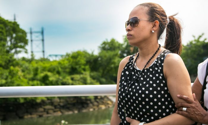 Eva Villa near the site where on Friday her son Erikson Villa and her nephew Wellington Gavin drowned in the Bronx River, in Starlight Park, in the Bronx New York City, on June 23, 2014. (Benjamin Chasteen/Epoch Times)