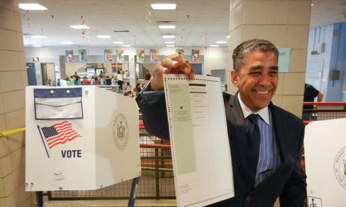 Candidate Adriano Espaillat  at Public School 98 on Tuesday morning, June 24, 2014. (Epoch Times)