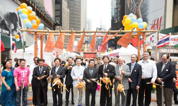 The ribbon cutting at the inaugural Taste Asia Food and Culture Festival on Times Square, in Manhattan, on June 25, 2014. Taste Asia is being presented by NTD Television and Epoch Times. (Edward Dai/Epoch Times)