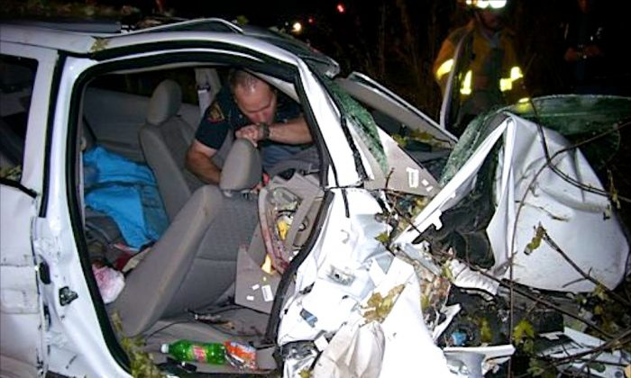 In this Oct. 24, 2006, photo provided by the St. Croix County Sheriff's Office, police investigate the wreckage of a 2005 Chevrolet Cobalt that crashed in St. Croix County, killing Natasha Weigel, 18, and Amy Lynn Rademaker, 15, and injuring the 17-year-old driver, Megan Ungar-Kerns. The vehicle's ignition was found in the accessory position and the air bags didn't deploy. General Motors' recent recall of 2.6 million small cars, including the 2005 Cobalt, has shed light on an unsettling fact: Air bags might not always deploy when drivers - and federal regulators - expect them to. (AP Photo/St. Croix County Sheriff's Office)