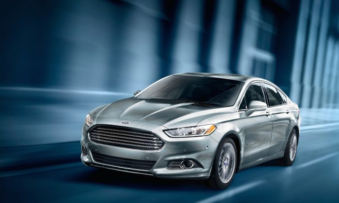 The new Ford Fusion Energi not only retracts energy through the wheels, it also can be charged electrically. (Ford)