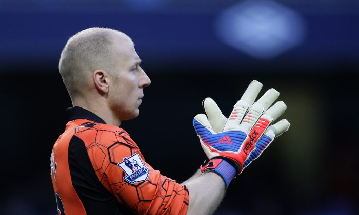 In this Nov. 17, 2012, photo Aston Villa's goalkeeper Brad Guzan looks on during a soccer match against in Manchester, England. Guzan, a standout in the English Premier League, would start for a number of World Cup teams. He'll be on the bench for the Americans, waiting for his turn behind veteran keeper Tim Howard. (AP Photo/Jon Super)