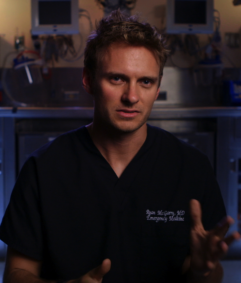 "ER doctor in blue scrubs in ""Code Black"""