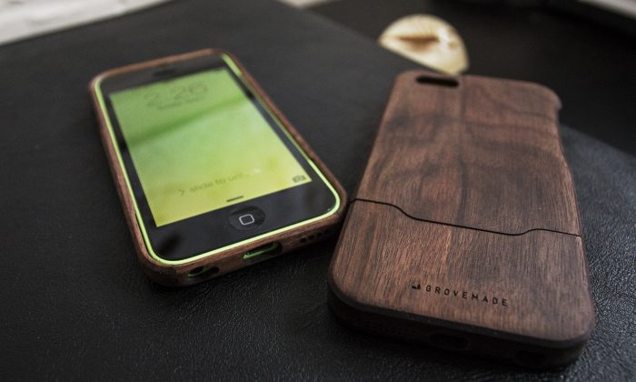 This June 1, 2014 photo shows walnut wood iPhone cases from Portland, Ore.-based Grovemade, in Decatur, Georgia. (AP Photo/Ron Harris)