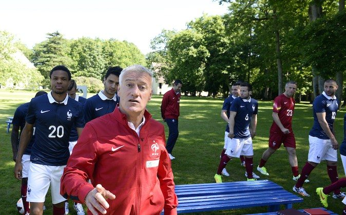 France's national football team head coach Didier Deschamps (Front) reacts after posing with France's players for a team group photo at the French national football team's training base in Clairefontaine-en-Yvelines, outside Paris, on June 6, 2014, during France's national football team's preparation for the upcoming FIFA 2014 World Cup in Brazil. (FRANCK FIFE/AFP/Getty Images)
