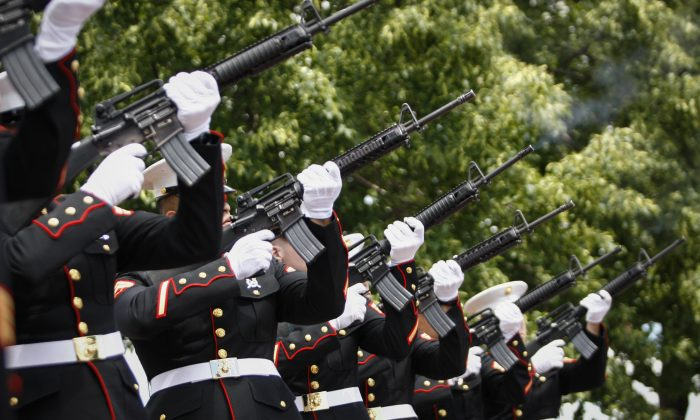 A group of Marines fire their arms during the Commemorating 70th Anniversary of D-Day on June 06, 2014 in New York City. Three helicopters have showered 1 million rose petals on the Statue during a event organized by the organization 'The French Will Never Forget' to mark the 70th anniversary of World War II D-Day landings. (Kena Betancur/Getty Images)