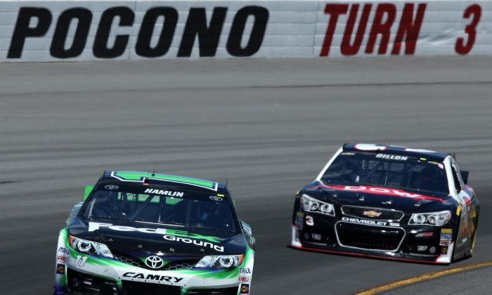Denny Hamlin, driver of the #11 FedEx Ground Toyota, leads Austin Dillon, driver of the #3 Dow Chevrolet, during practice for the NASCAR Sprint Cup Series Pocono 400 at Pocono Raceway on June 7, 2014 in Long Pond, Pennsylvania. (Doug Pensinger/Getty Images)