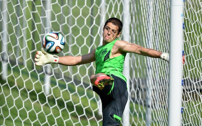 Mexico's forward Javier Hernandez acts as goalkeeper during a training session at the Modesto Roma Complex in Santos , Sao Paulo, Brazil on June 8, 2014. (YURI CORTEZ/AFP/Getty Images)