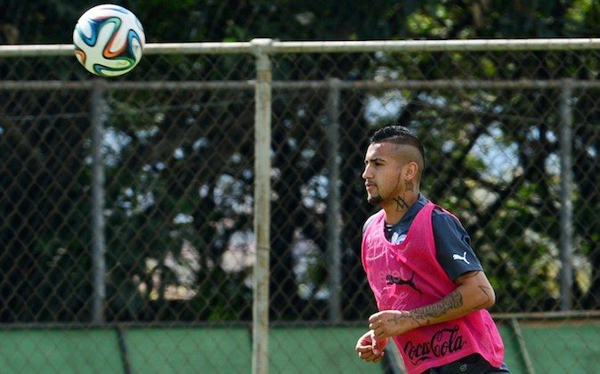 Chile's national football team midfielder Arturo Vidal runs for the ball during a training session at the Toca da Raposa training ground in Belo Horizonte, on June 11, 2014, ahead of the 2014 FIFA World Cup in Brazil. (MARTIN BERNETTI/AFP/Getty Images)