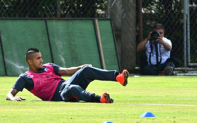 Chile's national football team midfielder Arturo Vidal rests on the ground during a training session at the Toca da Raposa training ground in Belo Horizonte, on June 11, 2014, ahead of the 2014 FIFA World Cup in Brazil. (MARTIN BERNETTI/AFP/Getty Images)