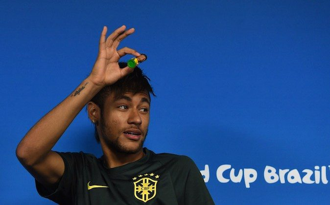 Brazil's forward Neymar looks at journalists during a press conference in Sao Paulo, Brazil on June 11, 2014 on the eve of the opening match of the 2014 FIFA World Cup between Brazil and Croatia. (PEDRO UGARTE/AFP/Getty Images)