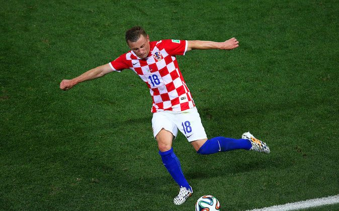 Ivica Olic of Croatia kicks the ball during the 2014 FIFA World Cup Brazil Group A match between Brazil and Croatia at Arena de Sao Paulo on June 12, 2014 in Sao Paulo, Brazil. (Photo by Elsa/Getty Images)
