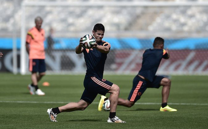 Colombia's midfielder James Rodriguez (C) streches during a training session at Mineirao Stadium in Belo Horizonte on June 13, 2014, on the eve of their 2014 FIFA World Cup Group C football match Colombia vs Greece. (ARIS MESSINIS/AFP/Getty Images)