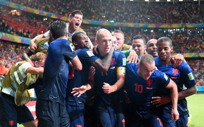 Netherlands' forward Arjen Robben (C) and his team-mates celebrate after Robben scored their fifth goal during a Group B football match between Spain and the Netherlands at the Fonte Nova Arena in Salvador during the 2014 FIFA World Cup on June 13, 2014. (DAMIEN MEYER/AFP/Getty Images)