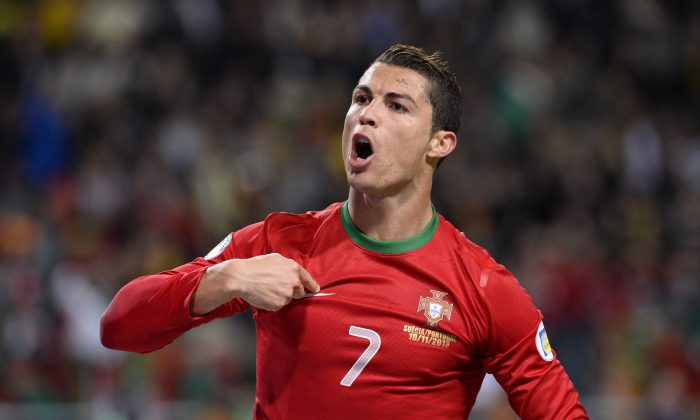 Portugal's forward Cristiano Ronaldo celebrates after scoring the second goal for Portugal during the FIFA 2014 World Cup playoff football match Sweden vs Portugal at the Friends Arena in Solna near Stockholm on November 19, 2013. (JONATHAN NACKSTRAND/AFP/Getty Images)