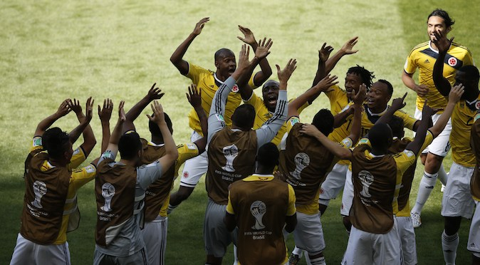 Colombia's defender Pablo Armero (C) celebrates with teammates after scoring during a Group C football match between Colombia and Greece at the Mineirao Arena in Belo Horizonte during the 2014 FIFA World Cup on June 14, 2014. (ADRIAN DENNIS/AFP/Getty Images)