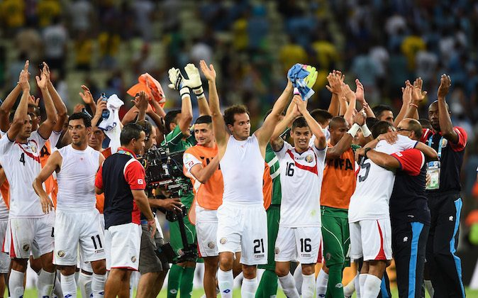 Costa Rica celebrate after defeating Uruguay 3-1 during the 2014 FIFA World Cup Brazil Group D match between Uruguay and Costa Rica at Castelao on June 14, 2014 in Fortaleza, Brazil. (Laurence Griffiths/Getty Images)