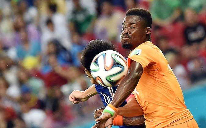 Ivory Coast's defender Serge Aurier heads the ball during a Group C football match between Ivory Coast and Japan at the Pernambuco Arena in Recife during the 2014 FIFA World Cup on June 14, 2014. (ISSOUF SANOGO/AFP/Getty Images)