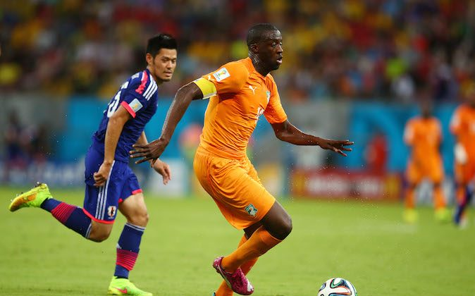 Yaya Toure of the Ivory Coast controls the ball against Hotaru Yamaguchi of Japan during the 2014 FIFA World Cup Brazil Group C match between the Ivory Coast and Japan at Arena Pernambuco on June 14, 2014 in Recife, Brazil. (Julian Finney/Getty Images)