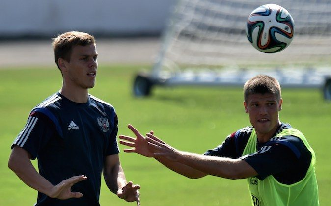 Russia's midfielder Igor Denisov (R) and Russia's forward Alexander Kokorin take part a training session at Estadio Novelli Jr in Itu on June 15, 2014, during the 2014 FIFA Football World Cup. (KIRILL KUDRYAVTSEV/AFP/Getty Images)