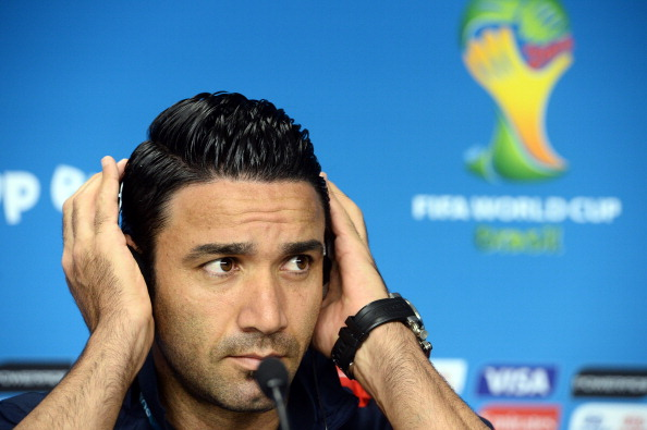 Iran's midfielder Javad Nekounam adjusts his headphones during a press conference before a team training session at the Baixada Arena in Curitiba on June 15, 2014, on the eve of their Group F 2014 FIFA World Cup football match against Nigeria. AFP PHOTO / Jewel Samad        (Photo credit should read JEWEL SAMAD/AFP/Getty Images)