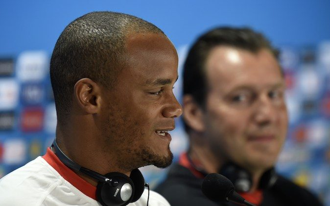 Belgium's defender Vincent Kompany speaks during a press conference at the Mineirao Stadium in Belo Horizonte on June 16, 2014, on the eve of their FIFA 2014 World Cup group H football match against Algeria. (PHILIPPE DESMAZES/AFP/Getty Images)