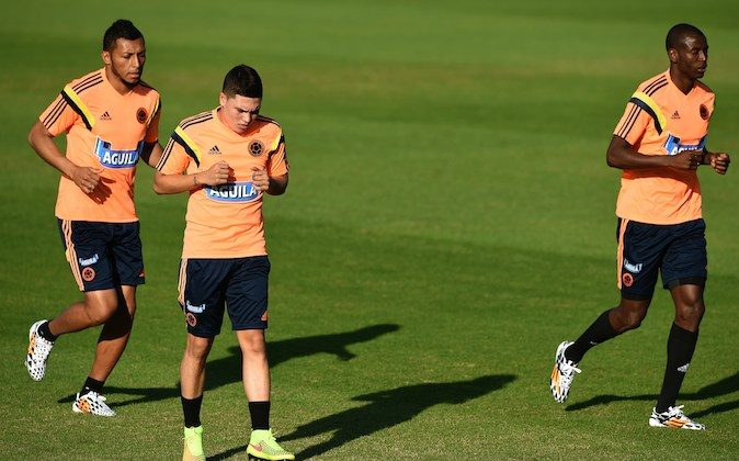Colombia's defender Carlos Valdes, Colombia's midfielder Juan Fernando Quintero and Colombia's forward Adrian Ramos take part in a training session at the President Laudo Natel Athlete Formation Center in Cotia, Sao Paulo, on June 16, 2014, during the 2014 FIFA World Cup. (EITAN ABRAMOVICH/AFP/Getty Images)