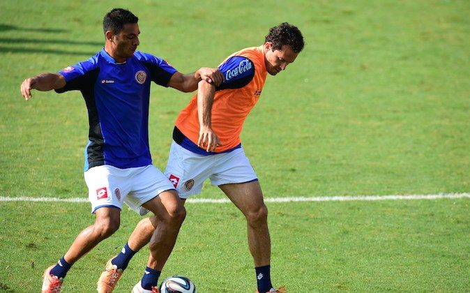 Costa Rica's defender Michael Umana (L) and forward Marco Urena (R) play the ball as they take part in a training session at The Vila Belmiro Stadium in Santos on June 17, 2014, during the 2014 FIFA World Cup in Brazil. Costa Rica will play Italy in Recife on June 20, in their Group D match of the tournament. (RONALDO SCHEMIDT/AFP/Getty Images)