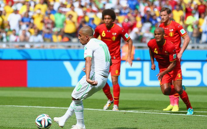 Sofiane Feghouli of Algeria scores his team's first goal on a penalty kick during the 2014 FIFA World Cup Brazil Group H match between Belgium and Algeria at Estadio Mineirao on June 17, 2014 in Belo Horizonte, Brazil. (Photo by Jeff Gross/Getty Images)