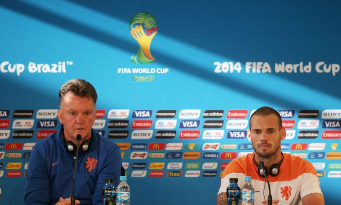 Manager of Netherlands Louis van Gaal and Wesley Sneijder get ready to speak to the media at the Netherlands Press Conference at the 2014 FIFA World Cup Brazil held at the Estadio Beira-Rio on June 17, 2014 in Porto Alegre, Brazil. (Dean Mouhtaropoulos/Getty Images)