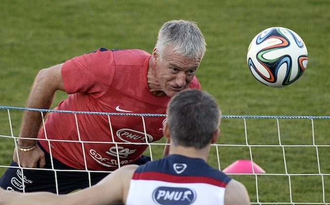France's coach Didier Deschamps heads a ball during a training session at the Santa Cruz Stadium in Ribeirao Preto during the 2014 FIFA World Cup football tournament on June 17, 2014. (FRANCK FIFE/AFP/Getty Images)