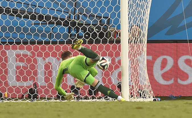 Russia's goalkeeper Igor Akinfeev fails to save the 0-1 goal during the Group H football match between Russia and South Korea in the Pantanal Arena in Cuiaba during the 2014 FIFA World Cup on June 17, 2014. (KIRILL KUDRYAVTSEV/AFP/Getty Images)
