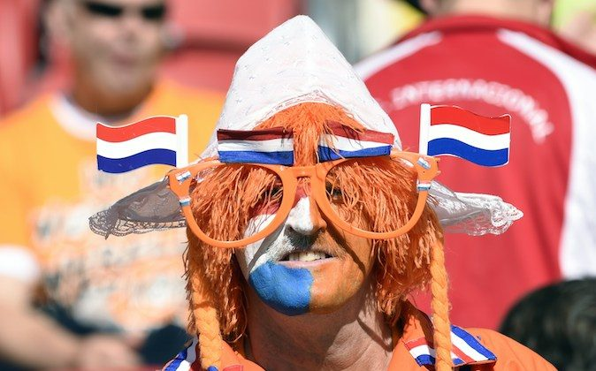 A Netherlands' supporter waits for the start of a Group B football match between Australia and the Netherlands at the Beira-Rio Stadium in Porto Alegre during the 2014 FIFA World Cup on June 18, 2014. (JUAN BARRETO/AFP/Getty Images)