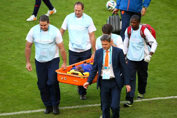 Bruno Martins Indi of the Netherlands is stretchered off the field during the 2014 FIFA World Cup Brazil Group B match between Australia and Netherlands at Estadio Beira-Rio on June 18, 2014 in Porto Alegre, Brazil. (Photo by Paul Gilham/Getty Images)