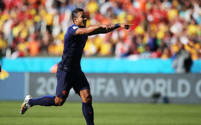 Memphis Depay of the Netherlands celebrates scoring his team's third goal during the 2014 FIFA World Cup Brazil Group B match between Australia and Netherlands at Estadio Beira-Rio on June 18, 2014 in Porto Alegre, Brazil. (Photo by Dean Mouhtaropoulos/Getty Images)