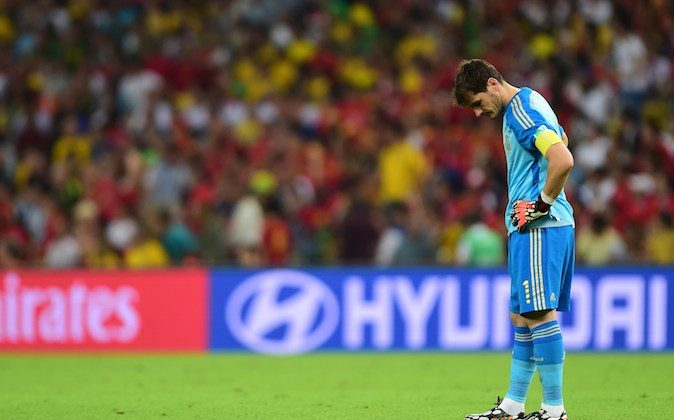 Spain's goalkeeper and captain Iker Casillas reacts during a Group B football match between Spain and Chile in the Maracana Stadium in Rio de Janeiro during the 2014 FIFA World Cup on June 18, 2014. (MARTIN BERNETTI/AFP/Getty Images)